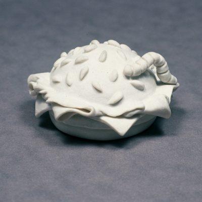 Caterpillar On Burger Netsuke ceramic sculpture by Tessa Eastman