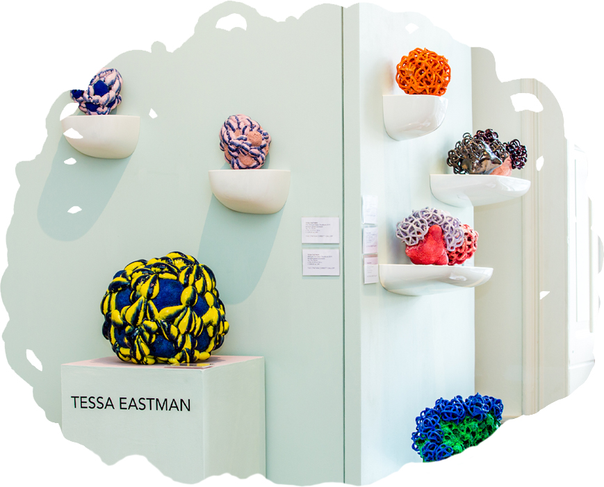 Tessa Eastman's colourful ceramic sculptures on display in a gallery