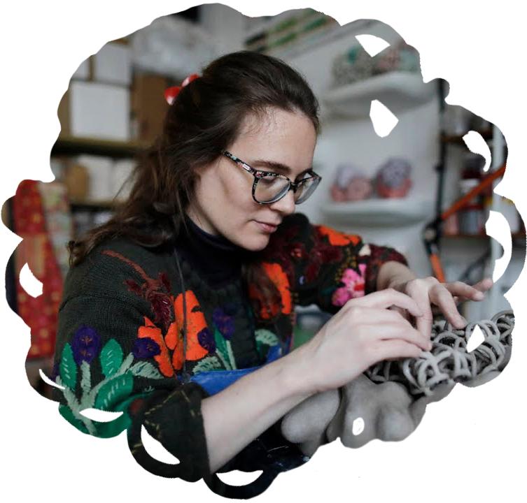 Tessa Eastman working on a ceramic sculpture