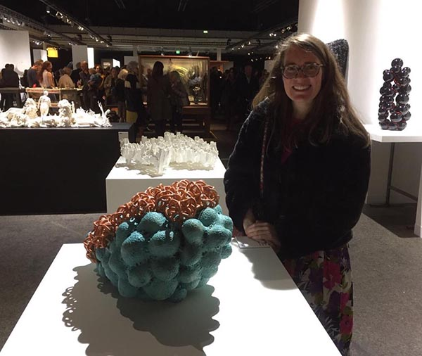 Tessa Eastman with her ceramic sculpture at art fair