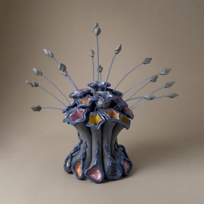 Bee on Bursting Blue Spray ceramic sculpture by Tessa Eastman