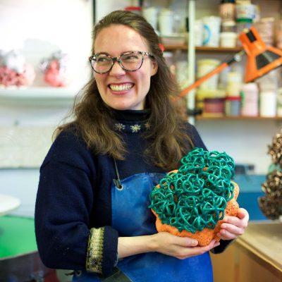 Residing Cloud Orange Emerald glazed ceramic sculpture by Tessa Eastman